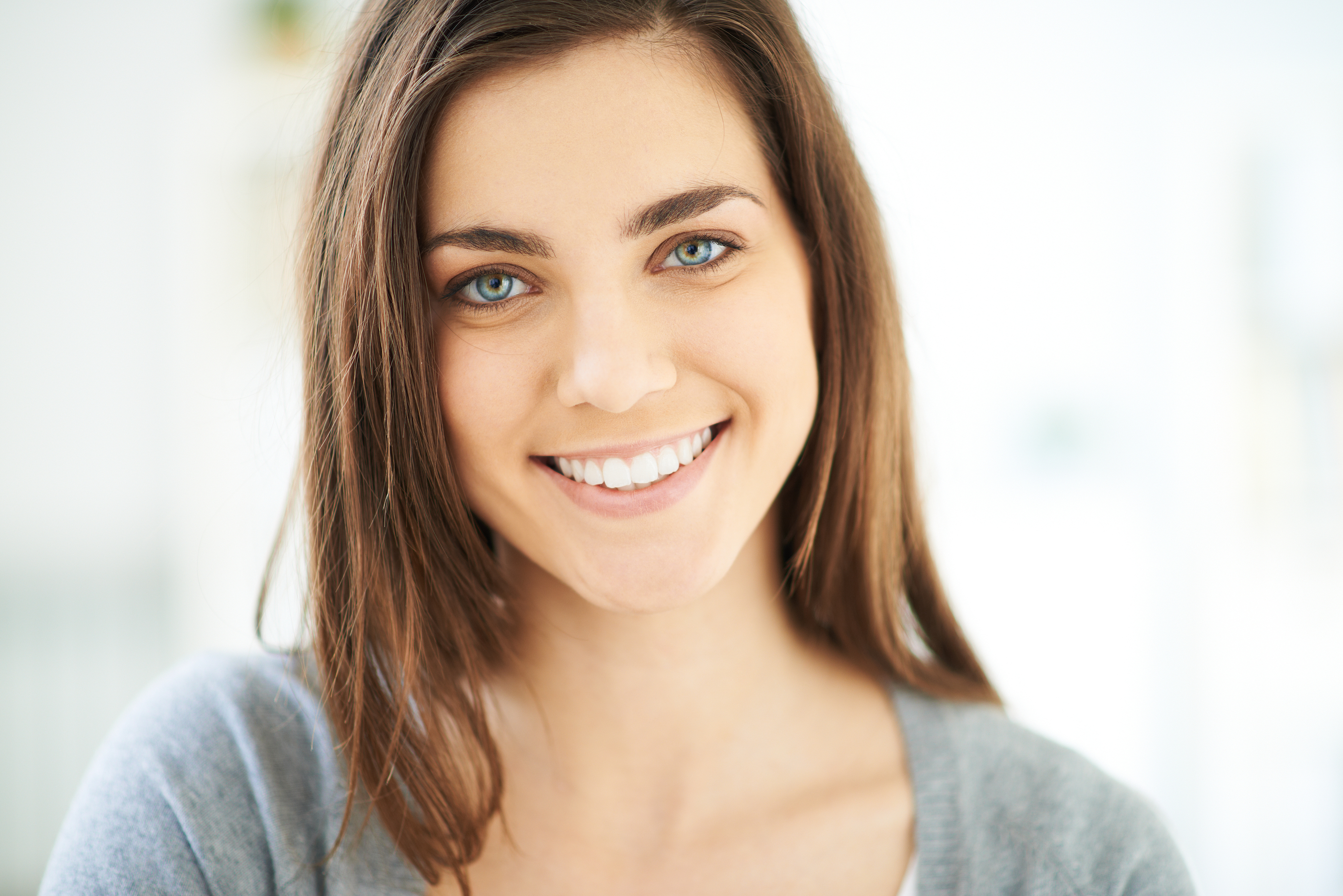 Happy young woman looking at camera with smile